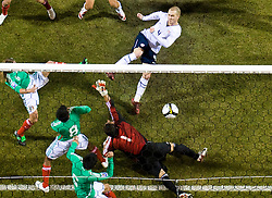 United States midfielder Michael Bradley (4) scores the games first goal past Mexico goalkeeper Oswaldo Sanchez (1) to put the US up 1-0.  The United States men's soccer team defeated the Mexican national team 2-0 in CONCACAF final group qualifying for the 2010 World Cup at Columbus Crew Stadium in Columbus, Ohio on February 11, 2009.