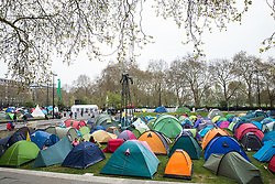 London, UK. 16th April 2019. Climate change activists from Extinction Rebellion congregate around tents pitched at Marble Arch on the second day of International Rebellion activities to call on the British government to take urgent action to combat climate change.