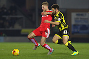 Chesterfield FC midfielder Gary Liddle and Burton Albion forward Mason Bennett challenge for the ball during the Sky Bet League 1 match between Burton Albion and Chesterfield at the Pirelli Stadium, Burton upon Trent, England on 12 February 2016. Photo by Aaron Lupton.