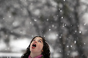Adrienne Bland, 8, strives to catch snow on her tongue while playing with her family and neighbors on Reiger Avenue in east Dallas Thursday February 11, 2010.