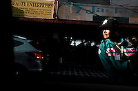 Traffic cop works busy street in Manila, Philippines. Copyright 2015 Reid McNally.