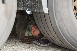 London, UK. 6 September, 2019. An activist is locked underneath a truck delivering to ExCel London on the fifth day of Stop the Arms Fair protests forming part of a week-long carnival of resistance against DSEI, the world's largest arms fair. The road remained blocked for several hours. The fifth day of protests was themed as Stop The Arms Fair: Stop Climate Change in order to highlight links between the fossil fuel and arms industries.