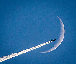 British Airways flight BA800 from London Heathrow to Reykjavik, Iceland, passes the moon in it's Waxing Crescent Phase, 20th January 2018 seen from Alloa, Scotland.