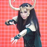London, UK - 26 May 2013: Emeraude deLioncourt dressed as Lady Loki poses for a picture during the London Comic Con 2013 at Excel London. London Comic Con is the UK's largest event dedicated to pop culture attracting thousands of artists, celebrities and fans of comic books, animes and movie memorabilia.