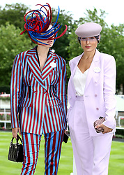 Marina Zubkova (left) and Valeria Stark pose for photographers during day two of Royal Ascot at Ascot Racecourse.