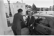 Charles Haughey Receives Seal Of Office.   (T3)..1989..12.07.1989..07.12.1989..12th July 1989..After winning the General Election and having been elected Taoiseach by a majority in Dail Eireann, Charles Haughey went to Aras an Uachtarain to accept the seal of office. The seal of office was granted by President Patrick Hillery...Image shows the newly elected Taoiseach, Charles Haughey TD, arriving at Aras an Uachtarain to receive his seal of office.