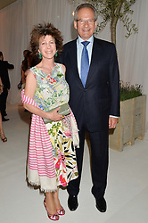 ROBERT & the HON.MRS WALEY-COHEN at a dinner hosted by Cartier in celebration of The Chelsea Flower Show held at The Hurlingham Club, London on 19th May 2014.