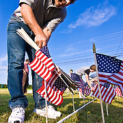 08/29/11 Bear DE: Volunteer Chuck D'Angelo install one of 6,194 flags that represents every soldier that died in the war on terror including three soldier that died in Afghanistan on Aug. 29, 2011. ..The flags will be seen on the front lawn of Glasgow Reformed Presbyterian Church...The News Journal/SAQUAN STIMPSON