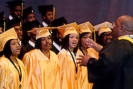 Music and band teacher Mr. Fedrick (right) leads the class of 2011 in the musical selection, 'I Need You To Survive,' during the Fiftieth Meadowdale High School commencement at the Dayton Masonic Center, Saturday, May 21, 2011.