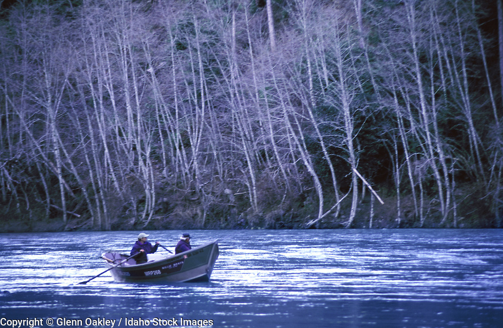 Two men enjoying a trip downstream in a driftboat.