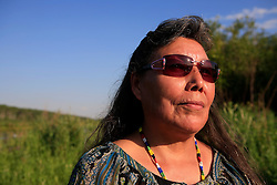 CANADA ALBERTA EDMONTON 24JUL09 - Portrait of Alice Marten of the Mikisew Cree First Nation by the river Athabasca in Fort McMurray, northern Alberta, Canada. Marten, a trained lawyer is a vocal critic of the tarsands operations and demands social justice for the First Nations people affected by the rapidly expanding industry...jre/Photo by Jiri Rezac / GREENPEACE..© Jiri Rezac 2009