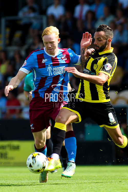 Burton Albion's Robbier Weir wins the ball from Luke Williams during the Sky Bet League 1 match between Burton Albion and Scunthorpe United at the Pirelli Stadium, Burton upon Trent, England on 8 August 2015. Photo by Aaron Lupton.
