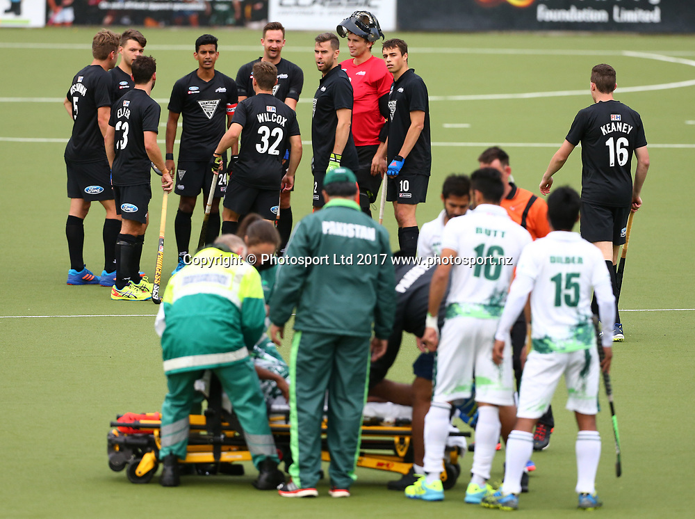 Blackstick players watch on as a Pakistan player is helped from the field injured during the 2nd International Hockey match, New Zealand Black Sticks V Pakistan. National Hockey Stadium, Wellington. 18th March 2017. © Copyright Photo: Grant Down / photosport.nz