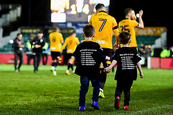 A pair of boys walk off with the players after the final whistle of the match with the FA Cup run fixtures printed on the back of their shirts - Mandatory by-line: Ryan Hiscott/JMP - 16/02/2019 - FOOTBALL - Rodney Parade - Newport, Wales - Newport County v Manchester City - Emirates FA Cup fifth round proper