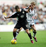Photo: Rich Eaton.<br /> <br /> Swansea City v Bristol City. Coca Cola League 1. 26/11/2006. Alex Russell #17 of Bristol left and holds off the tackle of Alan Tate of Swansea