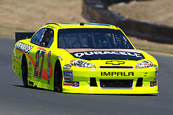 June 24, 2011; Sonoma, CA, USA;  NASCAR Sprint Cup Series driver Paul Menard (27) approaches turn 8 during practice for the Toyota/Save Mart 350 at Infineon Raceway.
