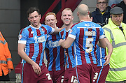 Scunthorpe celebrate Neil Bishop of Scunthorpe United scoring goal to 1-0 up  during the Sky Bet League 1 match between Scunthorpe United and Burton Albion at Glanford Park, Scunthorpe, England on 9 April 2016. Photo by Ian Lyall.