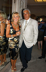 MR & MRS DAVID MORRIS he is the jewelle at a party to celebrate the re-opening of the David Morris Flagship store at 180 New Bond Street, London on 14th June 2006.<br /><br />NON EXCLUSIVE - WORLD RIGHTS