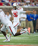 DALLAS, TX - AUGUST 30: Ryan Erxleben #26 of the Texas Tech Red Raiders punts the ball against the SMU Mustangs on August 30, 2013 at Gerald J. Ford Stadium in Dallas, Texas.  (Photo by Cooper Neill/Getty Images) *** Local Caption *** Ryan Erxleben