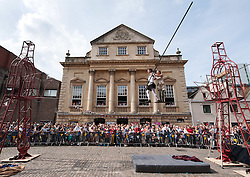 © Licensed to London News Pictures.30/05/2016. Bristol, UK.  Bullzini Family Funambulists perform on the high wire in front of the Bristol Old Vic in King Street as the theatre celebrates its 250th birthday on 30 May 2016 as the oldest continuously working theatre in the English speaking world. Following a recent £12.5 million redevelopment project, the Bristol Old Vic is now one of the most modern and comfortable theatres with state of the art rehearsal rooms, a dramatically extended forestage and precision-engineered sightlines giving audiences an even more intimate theatrical experience. Photo credit : Simon Chapman/LNP