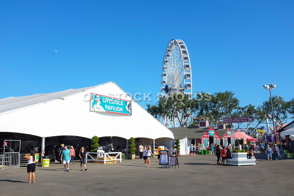 People Walking Past the Livestock Pavilion at the OC Fairgrounds