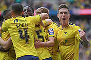 Oxford players celebrate scoring the opening goal of the final, 1-0 during the Johnstone's Paint Trophy Final between Barnsley and Oxford United at Wembley Stadium, London, England on 3 April 2016. Photo by Mark P Doherty.