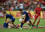 Canada's Harry Jones knocks the ball free from USA's Danny Barrett during the HSBC World Rugby Sevens Series, Singapore, Cup Final match USA -V- Canada  at The National Stadium, Singapore on Sunday, April 16, 2017. (Steve Flynn/Image of Sport)