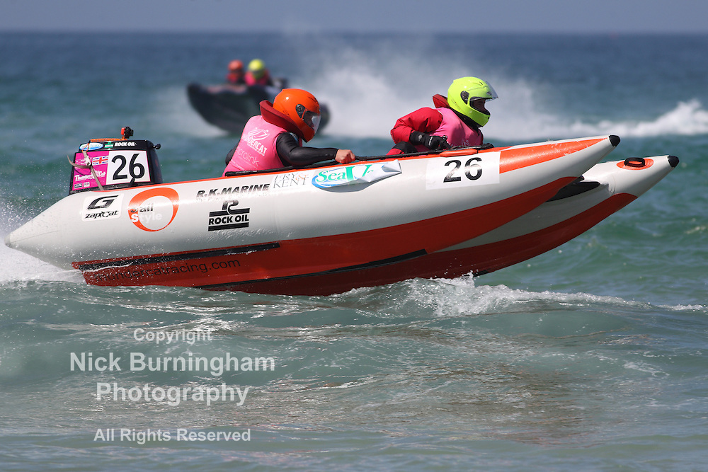 FISTRAL BEACH, NEWQUAY, CORNWALL, UK - MAY 14, 2016: The 2016 ThunderCat Racing Championship takes place at Fistral Beach.  Twenty 4m long inflatable boats take part in the race each equipped with 50 hp motors with a driver and copilot.