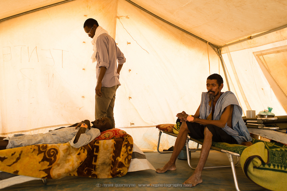 Dr Elghassoum Wane checking on patients in an isolation ward at a Médecins Sans Frontières (MSF) health centre at the Mbera camp for Malian refugees in Mauritania, on 5 March 2013.