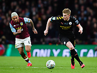 Football - 2020 EFL Carabao (League) Cup Final - Aston Villa vs. Manchester City<br /> <br /> Manchester City's Kevin De Bruyne holds off the challenge from Aston Villa's Douglas Luiz, at Wembley Stadium.<br /> <br /> COLORSPORT/ASHLEY WESTERN