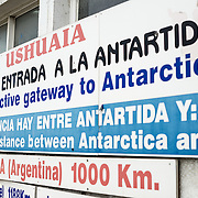 Signs indicating the Antarctic Gateway to Antarctica in Ushuaia, Argentina.
