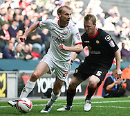 Picture by David Horn/Focus Images Ltd +44 7545 970036.29/09/2012.Luke Chadwick of Milton Keynes Dons and Mark Ellis of Crewe Alexandra during the npower League 1 match at stadium:mk, Milton Keynes.