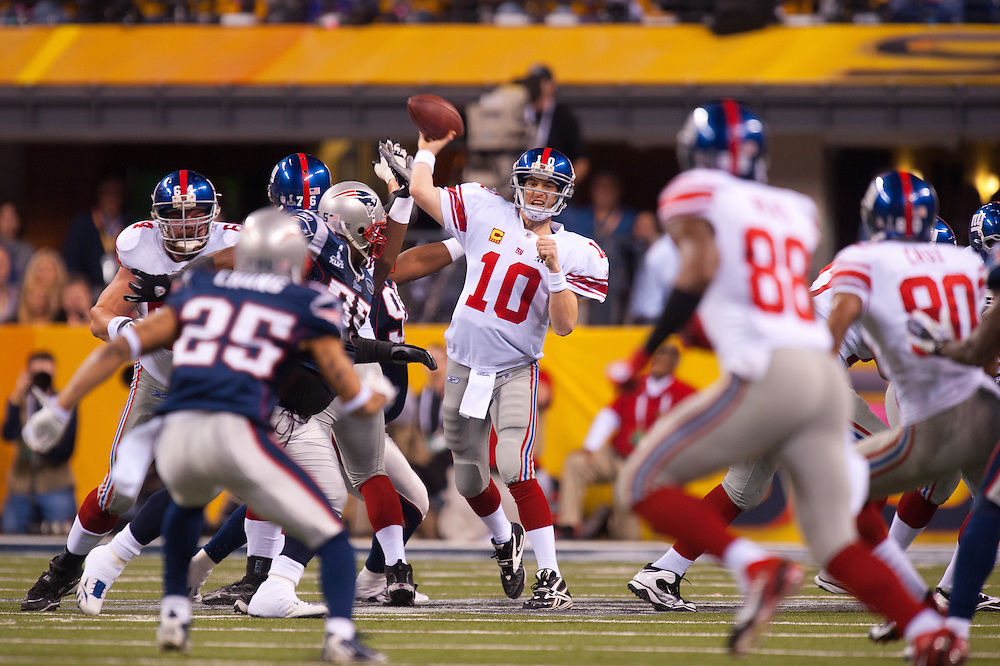 INDIANAPOLIS, IN - FEBRUARY 05: Eli Manning #10 of the New York Giants drops back to pass during Super Bowl XLVI  against the New England Patriots at Lucas Oil Stadium on February 5, 2012. (Photo by Rob Tringali) *** Local Caption *** Eli Manning