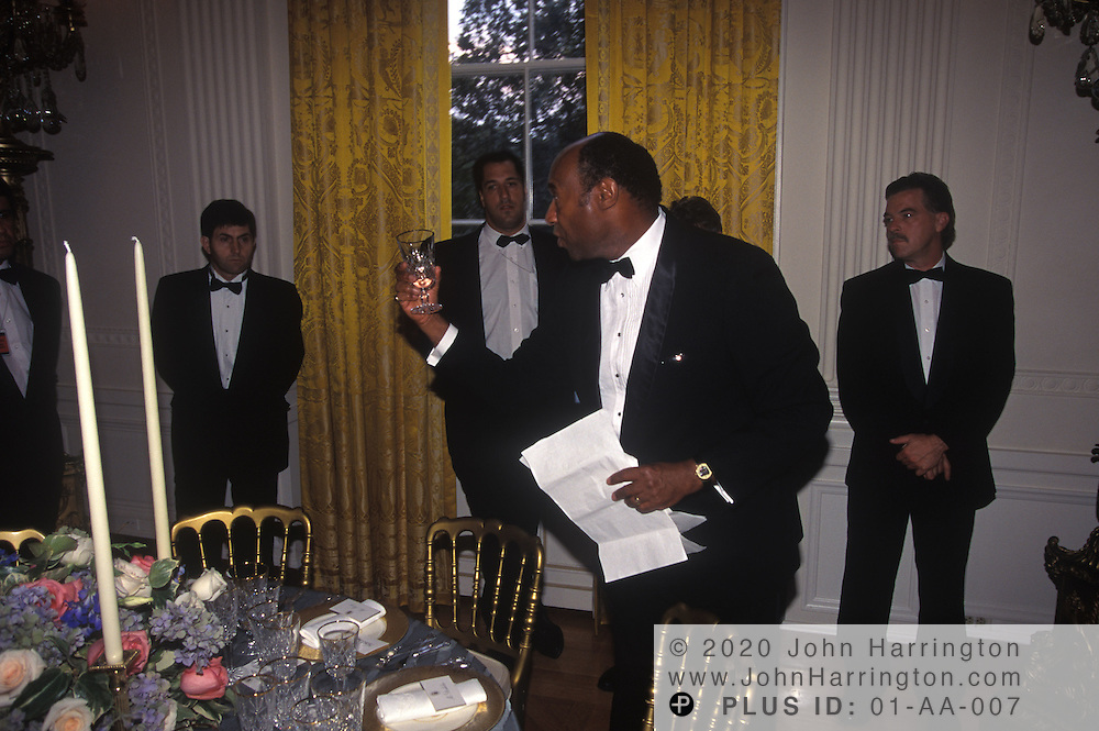 BUTLERS ARE GIVEN THE DETAILS OF THE STATE DINNER DURING A BRIEFING PRIOR TO THE BEGINNING OF A STATE DINNER.