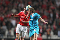 20120306: LISBON, PORTUGAL - Champions League 2011/2012 - 2st leg: SL Benfica vs Zenit FC.<br /> In picture: Benfica's forward Oscar Cardozo win the fighting with Zenit's defender Nicolas Lombaerts in the air for the ball.<br /> PHOTO: Carlos Rodrigues/CITYFILES