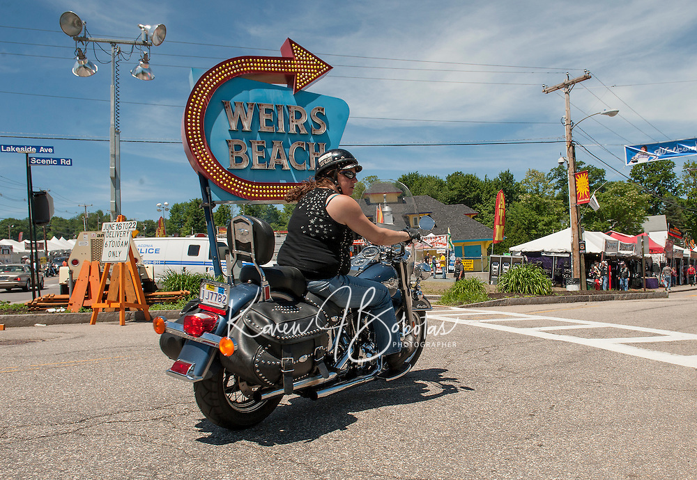 A steady flow of bikes channel down Lakeside Avenue for a busy start for Laconia's 2014 Motorcycle Week.  (Karen Bobotas/for the Laconia Daily Sun)