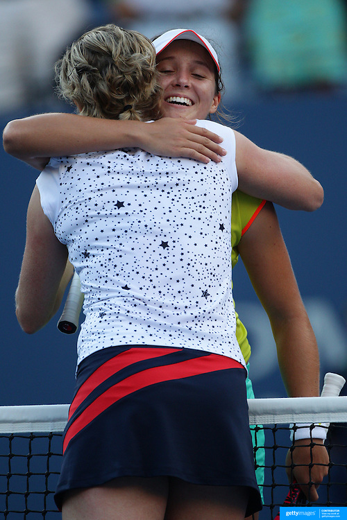 Laura Robson, Great Britain, hugs Kim Clijsters, Belgium after defeating her during the US Open Tennis Tournament, Flushing, New York. USA. 29th August 2012. Photo Tim Clayton