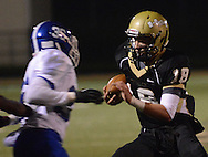 LEVITTOWN, PA - OCTOBER 31: Truman's Mark Lopez #18 runs with the football as Norristown's Charles<br /> Sanders #36 chases him in the first quarter at Harry S. Truman high school  October 31, 2014 in Levittown, Pennsylvania. (Photo by William Thomas Cain/Cain Images)