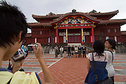 Shurijo? Castle. Tourists taking souvenir photos at Una forecourt in front of the Seiden (main hall).