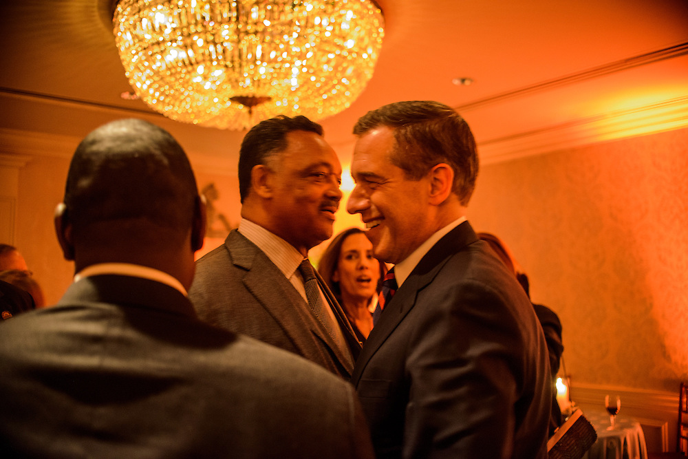 """Photo by Matt Roth.Assignment ID: 10137379A..Reverend Jesse Jackson and news anchor Brian Williams talk during an inaugural """"Bi-Partisan Celebration"""" hosted by Buffy and Bill Cafritz, Ann and Vernon Jordan, Vicki and Roger Sant's at the Dolley Madison Ballroom at the Madison Hotel in Washington, D.C. on Monday, January 21, 2013."""