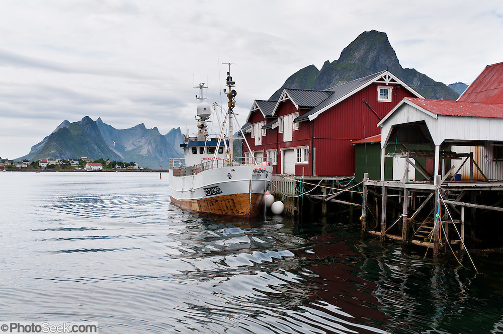 A ship anchors at the town of Reine on Moskenesøya (the Moskenes Island), in the Lofoten archipelago in Nordland county, Norway