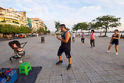 Phnom Penh, Cambodia. Morning sports along Preah Sisowath Quay.<br /> Disco dancing.