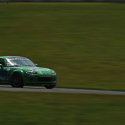 May 23, 2009; Lakeville, CT, USA; The Freedom Autosport Mazda MX-5 qualifies for Grand-Am Koni Sports Car Challenge series competition during the Memorial Day Road Racing Classic weekend at Lime Rock Park.
