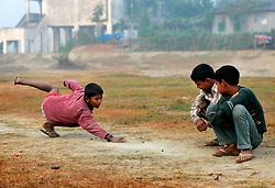 BANGLADESH SIRAJGANJ RADHUNIBARI 30JAN07 - Young Bangladeshi boys play a game of marbles...jre/Photo by Jiri Rezac..© Jiri Rezac 2007..Contact: +44 (0) 7050 110 417.Mobile:  +44 (0) 7801 337 683.Office:  +44 (0) 20 8968 9635..Email:   jiri@jirirezac.com.Web:    www.jirirezac.com..© All images Jiri Rezac 2007 - All rights reserved.