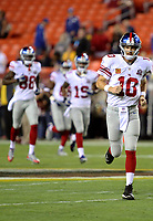 September 25, 2014: New York Giants quarterback Eli Manning (10) leads his team onto the field before a match between the Washington Redskins and the New York Giants at FedEx field in Landover, Maryland. NFL American Football Herren USA SEP 25 Giants at Redskins PUBLICATIONxINxGERxSUIxAUTxHUNxRUSxSWExNORxONLY Icon14092553<br /> <br /> September 25 2014 New York Giants Quarterback Eli Manning 10 leads His team onto The Field Before A Match between The Washington Redskins and The New York Giants AT FedEx Field in Landover Maryland NFL American Football men USA Sep 25 Giants AT Redskins PUBLICATIONxINxGERxSUIxAUTxHUNxRUSxSWExNORxONLY