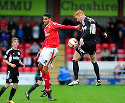 Crewe Alexandra's Kevin Mellor pulls on the shirt of Bristol City's Ryan Taylor whilst jumping up for the ball - Photo mandatory by-line: Dougie Allward/JMP - Tel: Mobile: 07966 386802 19/10/2013 - SPORT - FOOTBALL - Alexandra Stadium - Crewe - Crewe V Bristol City - Sky Bet League One
