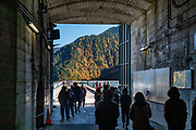 Kurobeko station of Kurobe Cablecar exits to Kurobe Dam. Kurobe Dam is Japan's tallest dam at 186 meters / 610 ft. Built with many difficulties over 7 years, it was completed in 1963. Over 170 people lost their lives to the project. Its hydropower plant supplies electricity to the Kansai Region. Kurobe Dam spans across Kurobe Lake in an arc, and it can be accessed via electric bus from the east or the cablecar from the west. Visitors walk over the dam to get between the bus and cablecar stations in about 10-15 minutes. At the eastern end of the dam, a long flight of stairs leads up the concrete-covered mountain slope for an aerial view of the dam and its surroundings. The Tateyama Kurobe Alpine Route carries visitors across the Northern Japan Alps via cablecars, trolley buses and a ropeway. Completed in 1971, this transportation corridor connects Toyama City in Toyama Prefecture with Omachi Town in Nagano Prefecture. The Tateyama Mountain Range lies within Chubu Sangaku National Park.