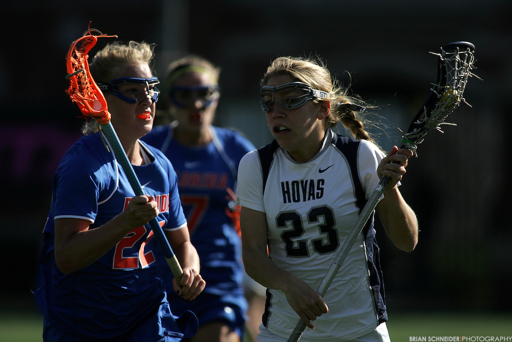 March 7, 2012; Washington, DC, USA; Florida Gators midfielder Brittany Dashiell (22) defends Georgetown Hoyas Rosie Corcoran (23) during the second half. Mandatory Credit: Brian Schneider-www.ebrianschneider.com