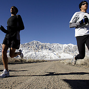 BISHOP, CA, January 19, 2008: Ryan Hall, in white shirt, trains for the Olympics with Steve Slattery at the base of the Eastern Sierra mountains outside the town of Bishop, California about 30 miles from Mammoth Lakes. The high altitude and clean air provide a picturesque and challenging training ground for the Olympic hopeful.
