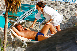 EXCLUSIVE: *NO WEB UNTIL 4PM BST 4TH SEPT* Chelsea head coach Antonio Conte and his wife Elisabeta Muscarello share a kiss in the ocean while on vacation in Italy. He is also seen reading Football English: Soccer Vocabulary for Learners of English book. Conte missed out on big players in the transfer window. 01 Sep 2017 Pictured: Antonio Conte and Elisabetta Muscarello. Photo credit: Ferraro Simone / MEGA TheMegaAgency.com +1 888 505 6342